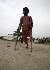 Shamshad, 8, walks with the help of crutches while she takes refuge in a flood relief camp managed by the Pakistani Marines in Sukkur
