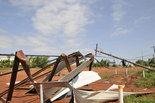 Downed power lines and sheet metal are seen in a neighborhood that took a direct hit from a tornado in Oklahoma City