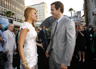 "Reynolds and Lively talk at the premiere of ""Green Lantern"" at the Grauman's Chinese theatre in Hollywood"