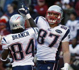 New England Patriots tight end Rob Gronkowski is congratulated by teammate Deion Branch during NFL game against Washington Redskins