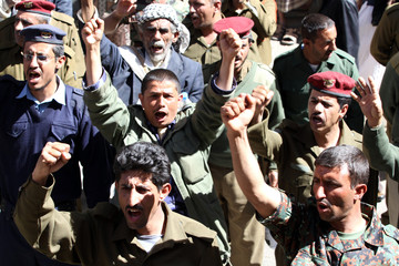 Police and army officers protest outside the House of Representatives to demand promotions and better pay, in Sanaa