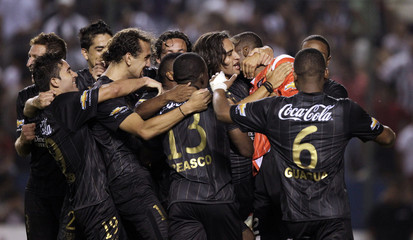 Goalkeeper Dominguez of LDU celebrates with teammates after their Copa Sudamericana soccer match against Libertad in Asuncion