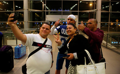 Cuban doctors take a photo as they prepare to travel to Miami, U.S., from El Dorado airport in Bogota