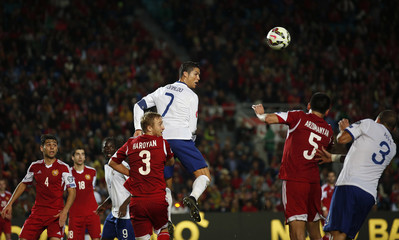 Portugal's Ronaldo heads the ball during their Euro 2016 qualifying soccer match against Armenia at Algarve stadium in Faro