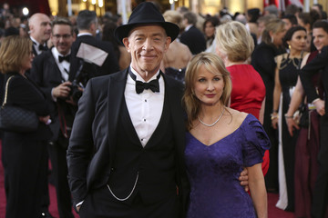 J.K. Simmons and wife Michelle Schumacher arrive at the 87th Academy Awards in Hollywood