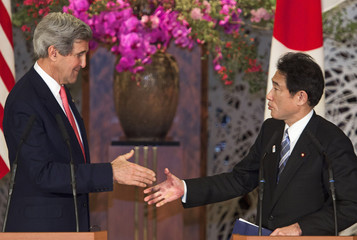 U.S. Secretary of State Kerry and Japan's Foreign Minister Kishida reach out to shake hands at the conclusion of a joint news conference at Iikura Guest House in Tokyo