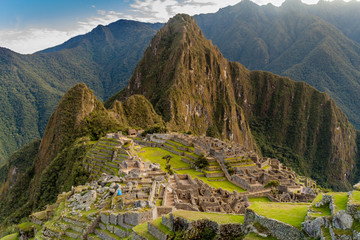 Aerial view of famous Mach Picchu ruins, Wayna Picchu mountain in the bacground.