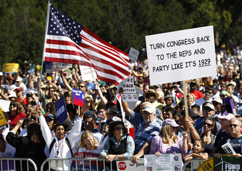 """Demonstrators pushing for progressive policies take part in the """"One Nation Working Together"""" rally on the National Mall in Washingto"""