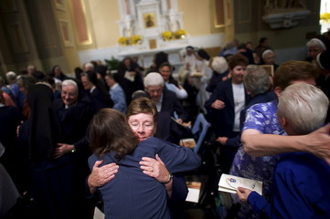 Nuns embrace each other during the greeting of peace as part of the papal mass attended by Pope Francis at the Cathedral Basilica of Saints Peter and Paul in Philadelphia, Pennsylvania