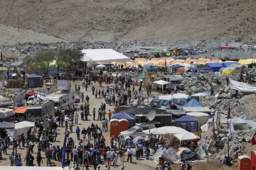Journalists from local and international news media work in the area known as Camp Esperanza  in Copiapo