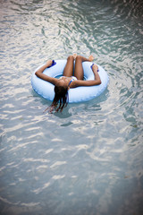 Girl floating in a rubber ring