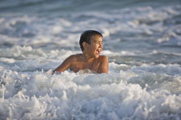 Boy swimming in the ocean