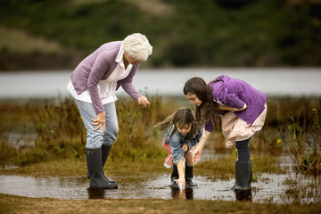 Mature woman exploring with her two granddaughters.