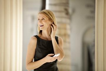 Businesswoman txt messaging on her cellphone.