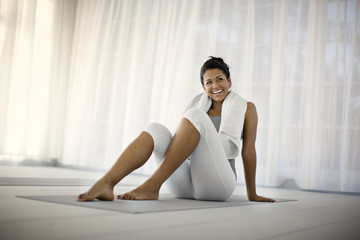 Smiling young woman relaxing after working out.