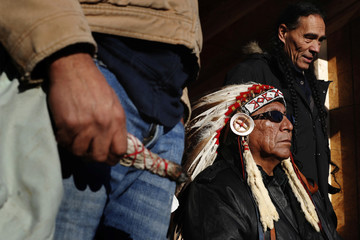 Chief Arvol Looking Horse of Green Grass South Dakota, who is the spiritual leader of the Lakota, Dakota and Nakota Sioux Nations listens to speakers inside of the Oceti Sakowin camp as demonstrations continue, near Cannon Ball