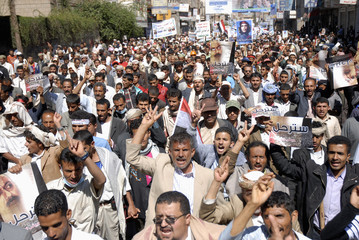 Anti-government protesters shout slogans in a march calling for the trial of Yemen's President Saleh and against the proposed immunity deal for him, in Sanaa