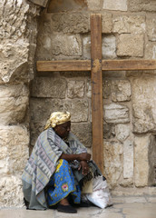 A tourist from Ethiopia rests in the Old City of Jerusalem