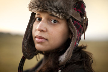 Portrait of girl wearing alpaca hat