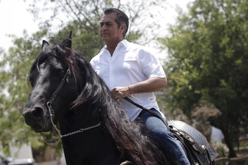 Jaime Rodriguez, governor-elect of Nuevo Leon state, rides on his horse inside his house before the official ceremony of delivery constancy as governor from the State Election Commission (CEE) in Monterrey
