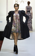 A model presents a creation by Georgia's designers Keti Chkhikvadze and Avtandil during Kazakhstan Fashion Week in Almaty