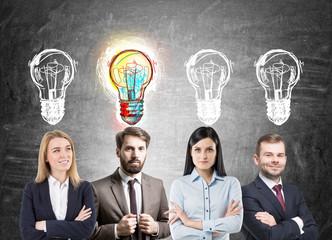 Business team brainstorming, light bulbs