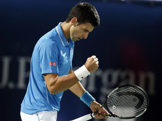 Djokovic of Serbia reacts during his match against Pospisil of Canada at their match at the ATP Championships tennis tournament in Dubai,