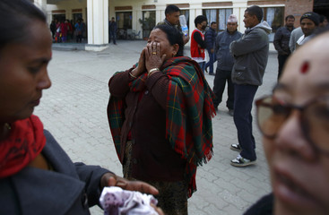 Thebe cries while protesting outside a hospital in Kathmandu