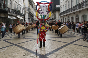 A Spanish reveler from Galiza performs during the Iberian Mask parade in Lisbon