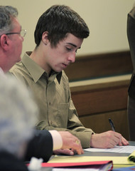 T.J. Lane signs document at juvenile court hearing to determine whether he will be tried as an adult in Chardon, Ohio