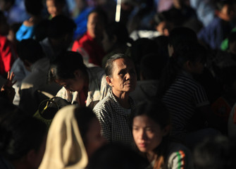Refugees, who fled Myanmar when a battle erupted between Myanmar's soldiers and rebels, rest at the Thai border town of Mae Sot