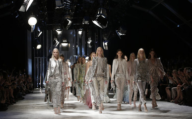 MModels present creations from the Roberto Cavalli Spring/Summer 2014 collection during Milan Fashion Week