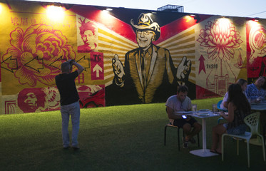 A man takes a photograph at the Wynwood Walls during this month's Art Walk in the Miami neighborhood of Wynwood