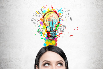 Woman with black hair and colorful light bulb