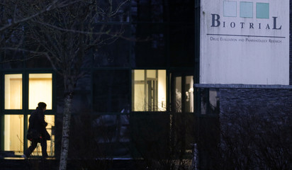 A man enters the Biotrial laboratory building in Rennes