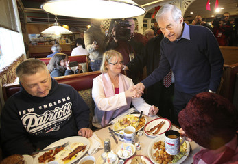 Republican presidential candidate and Congressman Ron Paul greets people at the The Windmill Family Restaurant in Concord, New Hampshire