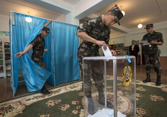 Kazakh Republican Guards vote during a snap presidential election in Almaty, Kazakhstan
