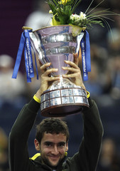 Cilic of Croatia holds the winners trophy after defeating Tipsarevic of Serbia in the men's singles final in St. Petersburg