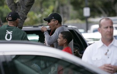 U.S. President Obama eats shave ice during his Christmas holiday vacation in Kailua