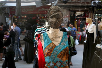 A mannequin with a covered face is pictured inside a market on the last week of the holy month of Ramadan in Al-Fardous neighbourhood of Aleppo, Syria
