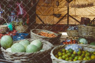 Baskets of vegetables at market stand