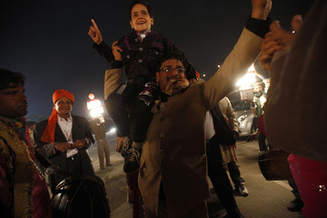 Relatives and friends of a groom dance during a wedding procession in New Delhi