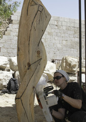 German sculptor Tanja Roder uses an electric saw on her work during her participation in the International Forum on Wood Carving at Damascus castle