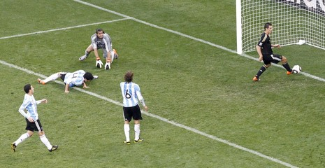 Germany's Miroslav Klose scores a goal at Green Point stadium