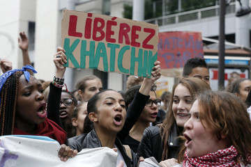 French high students shout slogans during a protest demonstration in Paris