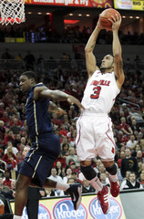 University of Louisville's Siva dunks against University of Pittsburgh's Taylor during the first half of play in their NCAA basketball game in Louisville
