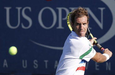 Gasquet of France hits a return to Montanes of Spain during their match at the U.S. Open tennis tournament in New York