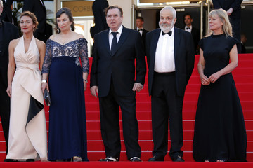 "Cast members Atkinson, Bailey, Spall, Director Leigh and an unidentified guest pose on the red carpet as they arrive for the screening of the film ""Mr. Turner"" in competition at the 67th Cannes Film Festival in Cannes"