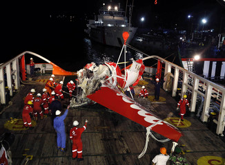 A section of the tail of AirAsia Flight QZ8501 passenger plane is seen on the deck of the rescue ship Crest Onyx at Kumai Port