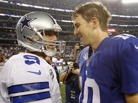 Dallas Cowboys quarterback Tony Romo and New York Giants quarterback Eli Manning talk following their NFL football game in Arlington, Texas